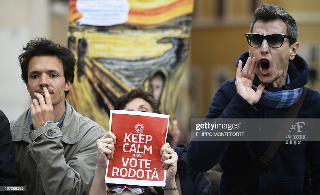 A Five Star Mouvement supporter holds a banner as she joins others outside the Italian Parliament on April 20, 2013 during the election of Italy's President. Italy's 87-year-old President Giorgio Napolitano on Saturday said he would run for a second term despite earlier ruling out the prospect, following an appeal from the main parties to help defuse an increasingly tense political crisis.'I consider it necessary to offer my availability,' Napolitano said in a statement, as bickering lawmakers prepared for a sixth round of voting in parliament that he is now expected to win by a large margin.