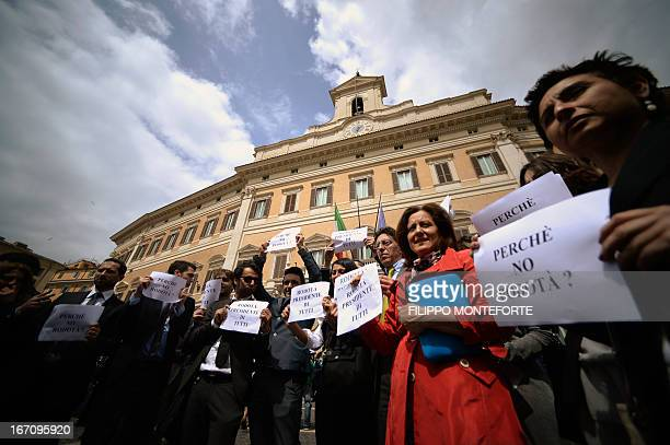 Five Star mouvement supporters demonstrate in front of the Italian Parliament in Rome in support of their candidate Stefano Rodota during the...