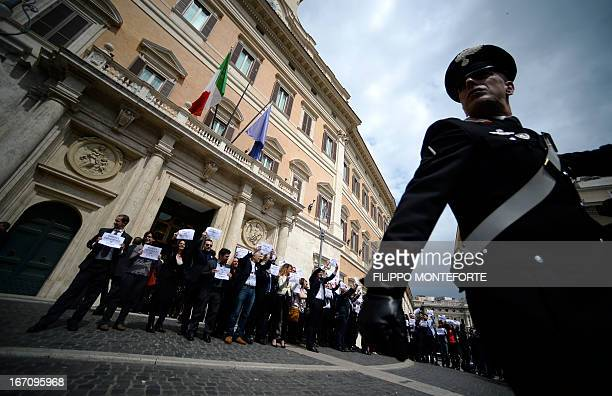 Five Star mouvement supporters demonstrate in front of the Italian Parliament in Rome in support of their candidate Stefano Rodota on April 202013...