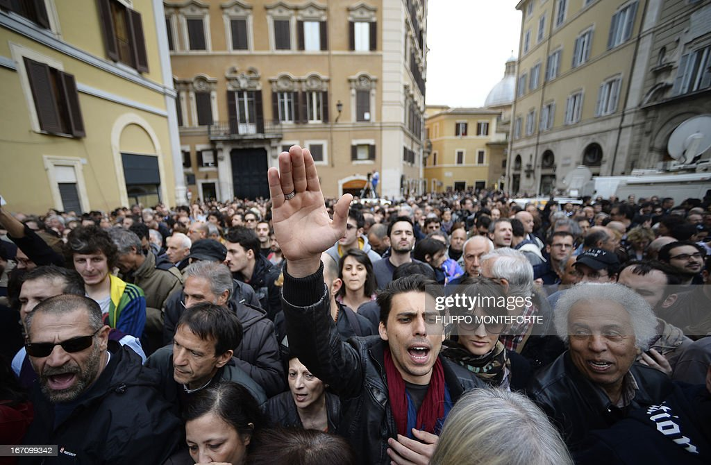 Five Star Mouvement supporters shout slogans as they gather outside the Italian Parliament in Rome on April 20, 2013 during the election of Italy's President. Italy's 87-year-old President Giorgio Napolitano on Saturday said he would run for a second term despite earlier ruling out the prospect, following an appeal from the main parties to help defuse an increasingly tense political crisis.'I consider it necessary to offer my availability,' Napolitano said in a statement, as bickering lawmakers prepared for a sixth round of voting in parliament that he is now expected to win by a large margin.