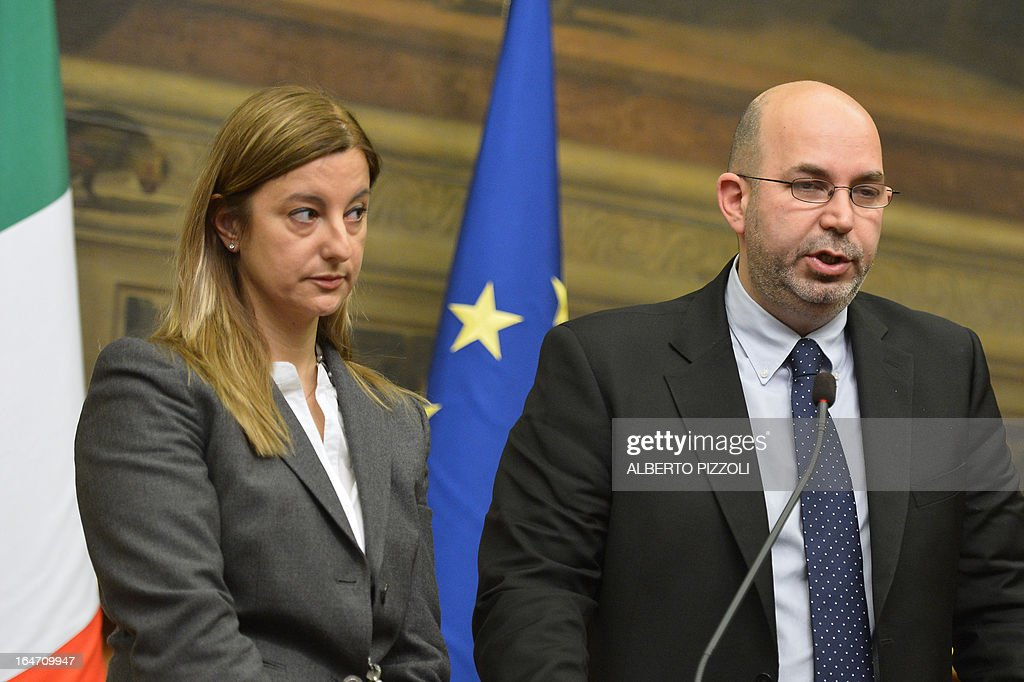 Five Star Movement leader in the Senate Vito Crimi (R) and 5-Star leader in the lower house of parliament Roberta Lombardi give a press conference after their meeting with leftist leader Pier Luigi Bersani on March 27, 2013 in Rome. Bersani was given the official go-ahead on March 23, 2013 to try and form a government after February elections that left the country in political gridlock.