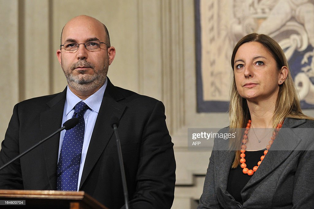 Five Star Movement leader in the Senate Vito Crimi (L) and 5-Star leader in the lower house of parliament Roberta Lombardi give a press conference after a meeting with Italy's President on March 29, 2013 at the Quirinale, the Italian presidential palace in Rome. Italian political leaders were poised for a new round of talks today after leftist Pier Luigi Bersani failed to form a government following inconclusive elections in eurozone's third-largest economy. President Giorgio Napolitano was scheduled to host the talks, as European capitals and financial markets watched warily amid renewed turbulence in the eurozone.