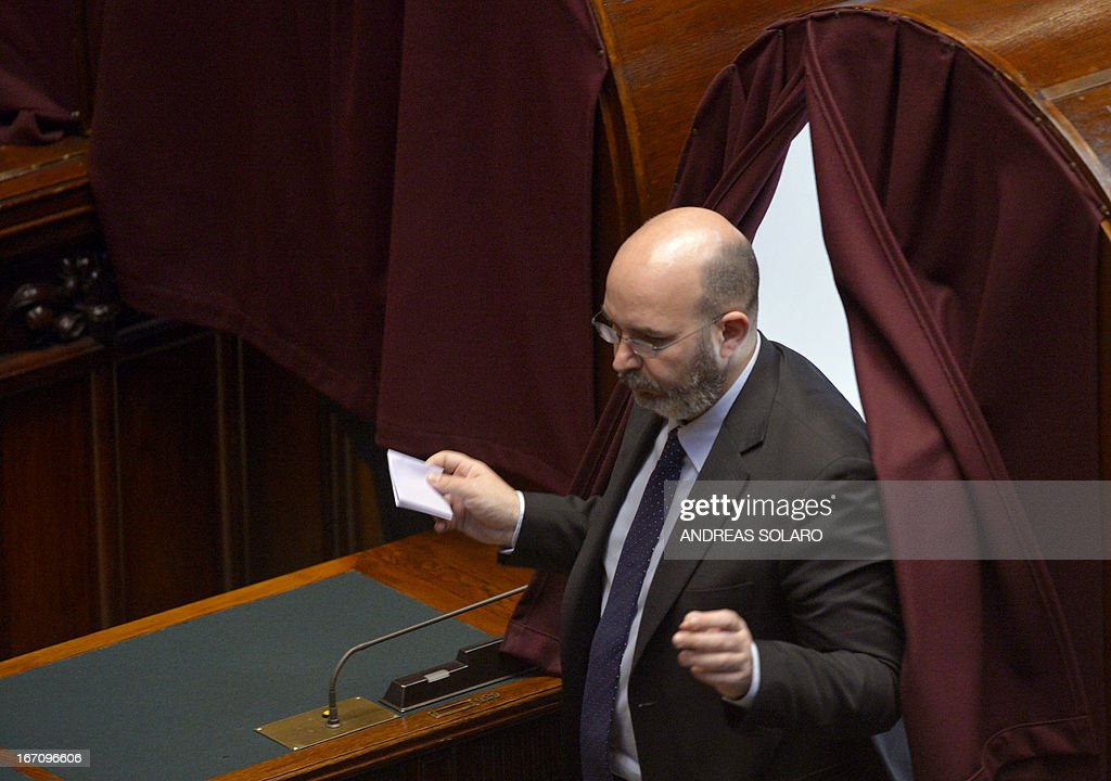 Five Star Movement leader in the Senate Vito Crimi leaves the voting booth during the election of Italy's President on April 20, 2013 at the Italian parliament in Rome. Italy's 87-year-old President Giorgio Napolitano on Saturday said he would run for a second term despite earlier ruling out the prospect, following an appeal from the main parties to help defuse an increasingly tense political crisis.'I consider it necessary to offer my availability,' Napolitano said in a statement, as bickering lawmakers prepared for a sixth round of voting in parliament that he is now expected to win by a large margin.