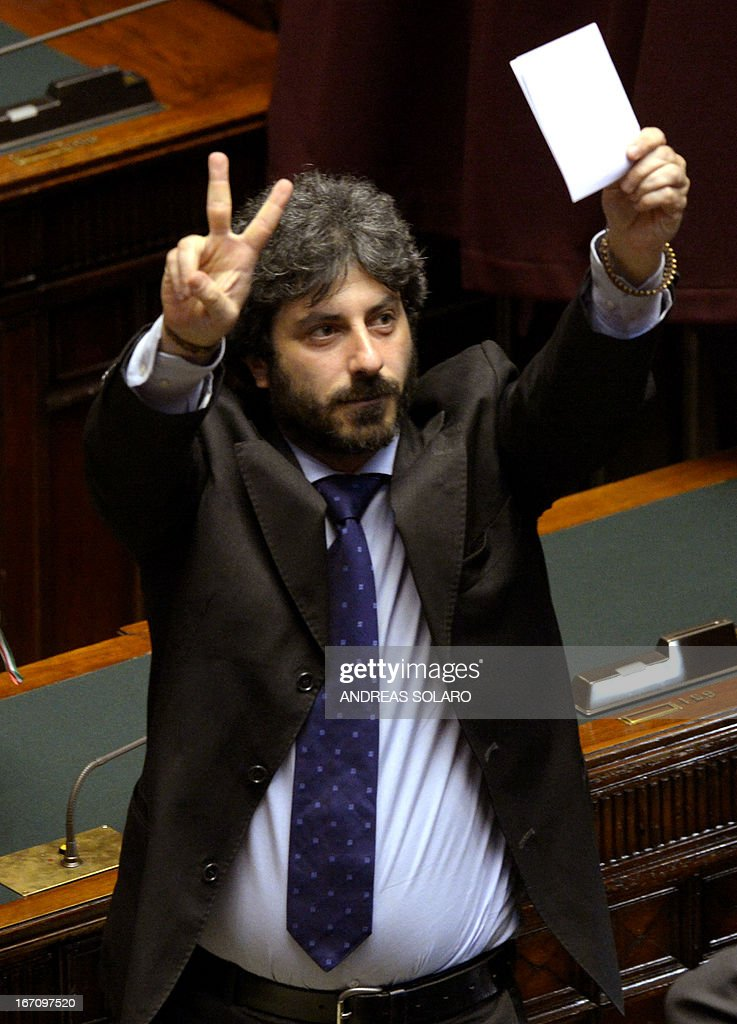 Five Star Movement member of parliament Roberto Fico shows the 'V' sign for victory before to cast his vote for the election of Italy's President on April 20, 2013 at the Italian parliament in Rome. Italy's 87-year-old President Giorgio Napolitano on Saturday said he would run for a second term despite earlier ruling out the prospect, following an appeal from the main parties to help defuse an increasingly tense political crisis.'I consider it necessary to offer my availability,' Napolitano said in a statement, as bickering lawmakers prepared for a sixth round of voting in parliament that he is now expected to win by a large margin.