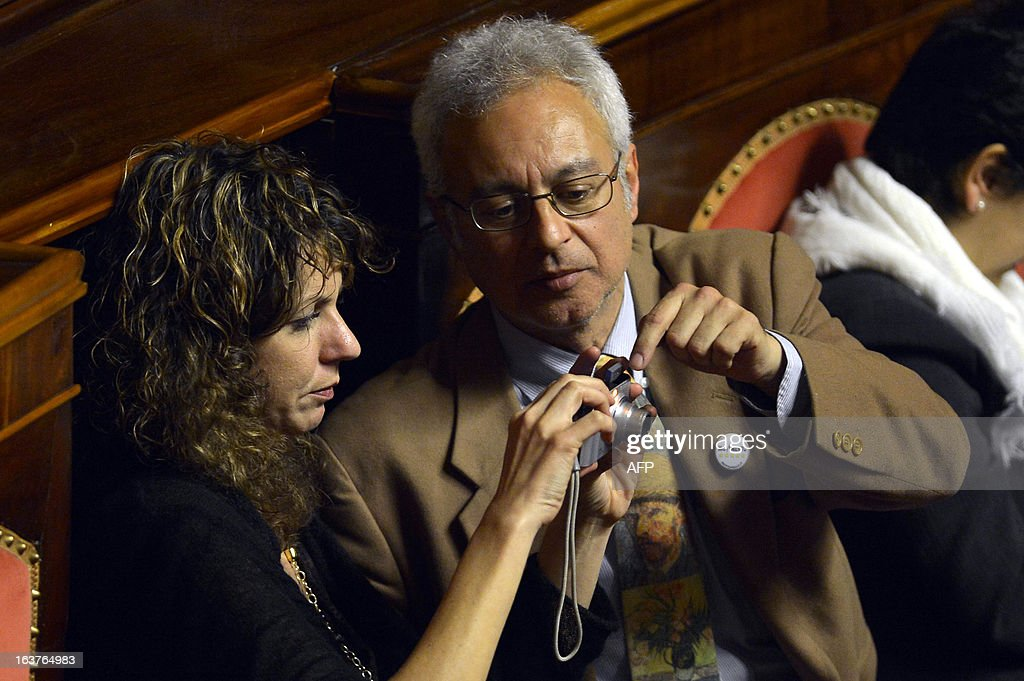 Five star movement newly elected senators Barbara Lezzi (L) and Roberto Ciotti during the first session of the senate on March 15, 2013 in Rome. General election in Italy took place on February 26 but as a majority in both chambers of parliament is required to form a government, Italy is left in a state of limbo with a hung parliament that is unprecedented in its post-war history.