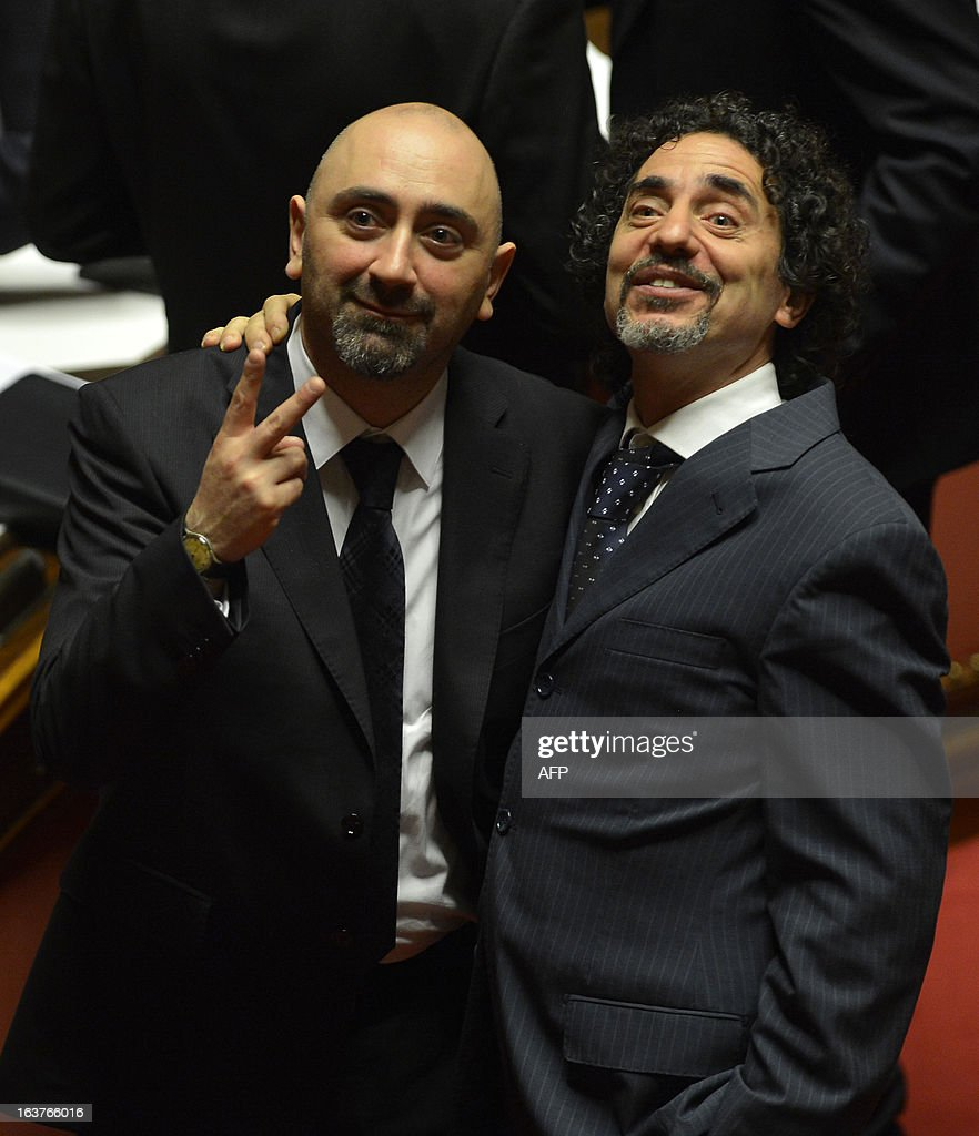 Five Star movement Stefano Lucidi and Andrea Cioffi (R) chat during the first session of the senate on March 15, 2013 in Rome. General election in Italy took place on February 26 but as a majority in both chambers of parliament is required to form a government, Italy is left in a state of limbo with a hung parliament that is unprecedented in its post-war history.