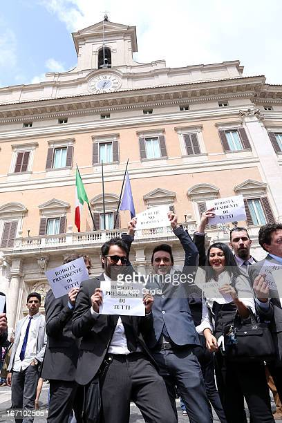 Five Stars Movement member holds a banner reading 'Rodota President of all' in front the Italian Chamber of Deputies as Parliament votes for...