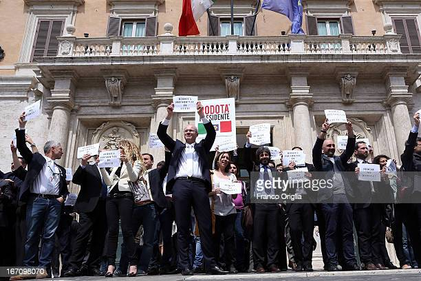 Five Stars Movement members hold banners reading 'Stefano Rodota for President' in front the Italian Chamber of Deputies as Parliament votes for...