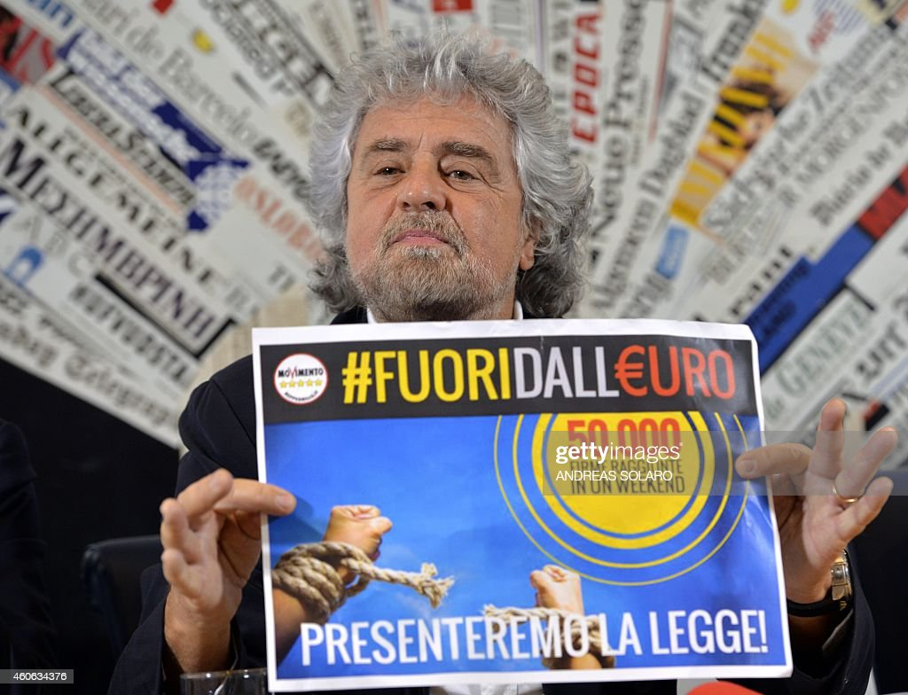 Five Stars movement's leader <a gi-track='captionPersonalityLinkClicked' href=/galleries/search?phrase=Beppe+Grillo&family=editorial&specificpeople=4246058 ng-click='$event.stopPropagation()'>Beppe Grillo</a> shows a paper reading 'Out of the Euro - 50.000 signatures in a week-end' during a press conference on December 18, 2014 in Rome.