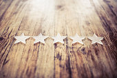 five stars on a wooden desk