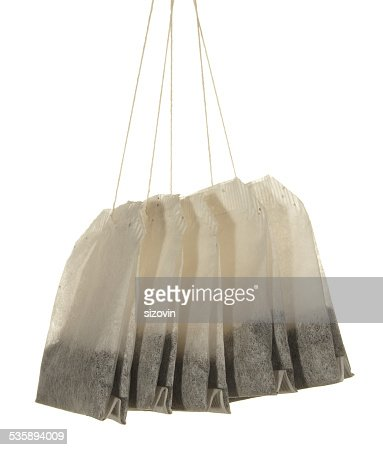 Five tea bags close-up isolated on white background : Stock Photo