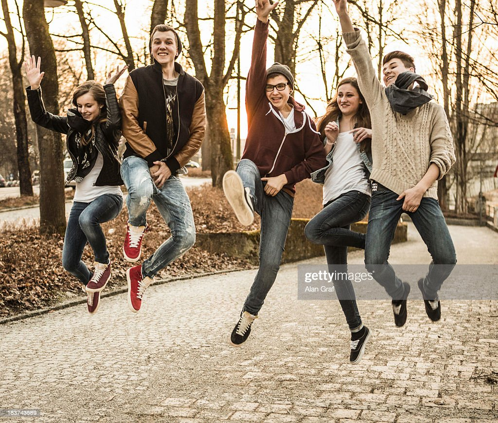 Five teenagers jumping