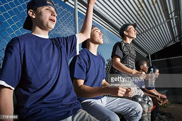 Five teenagers watching from the sidelines