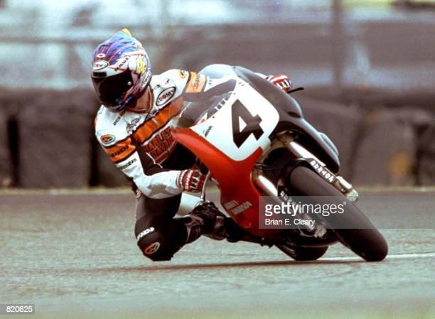 Five time Daytona 200 winner Scott Russell races through a turn at Daytona International Speedway during practice fir this year's Daytona 200 on...