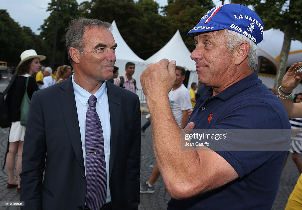 Five time winner of the Tour de France <a gi-track='captionPersonalityLinkClicked' href=/galleries/search?phrase=Bernard+Hinault&family=editorial&specificpeople=749939 ng-click='$event.stopPropagation()'>Bernard Hinault</a> chats with three time winner of the Tour <a gi-track='captionPersonalityLinkClicked' href=/galleries/search?phrase=Greg+LeMond&family=editorial&specificpeople=504953 ng-click='$event.stopPropagation()'>Greg LeMond</a> of USA following the twenty one and last stage of the 2014 Tour de France, a 134 km individual time trial stage between Evry and the Champs-Elysees in Paris on July 27, 2014 in Paris, France.