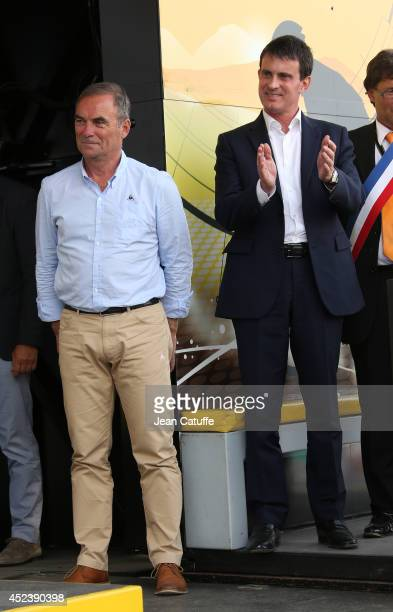 Five times winner of the Tour de France Bernard Hinault and French Prime Minister Manuel Valls participate in the podium ceremony following stage...