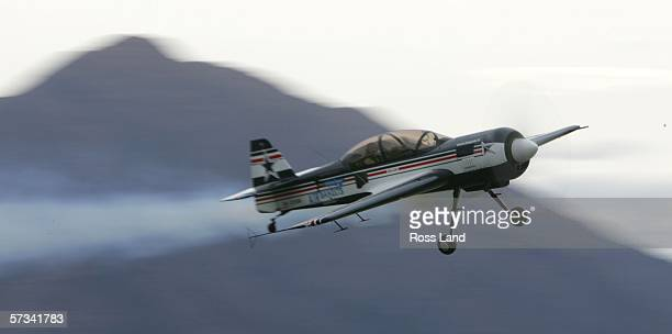 Five times Womens World Champion aerobatic champion Svetlana Kapanina in action in a Sukhoi 29 over the airfield during the 'Warbirds over Wanaka'...