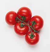 Five tomatoes on the vine, view from above