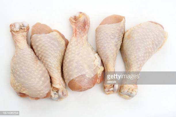 five uncooked chicken drumsticks