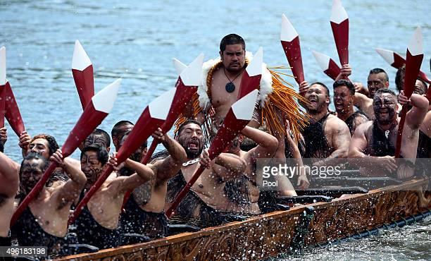 Five waka maori canoes on the Waikato River salute Prince Charles Prince of Wales and Camilla Duchess of Cornwall at Turangawaewae Marae on November...