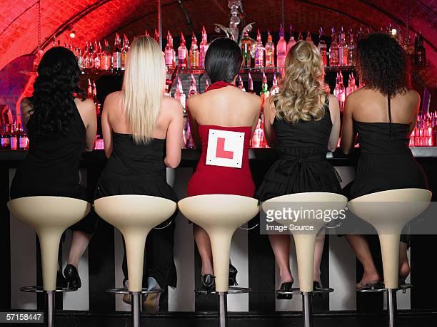 Five women sitting at bar