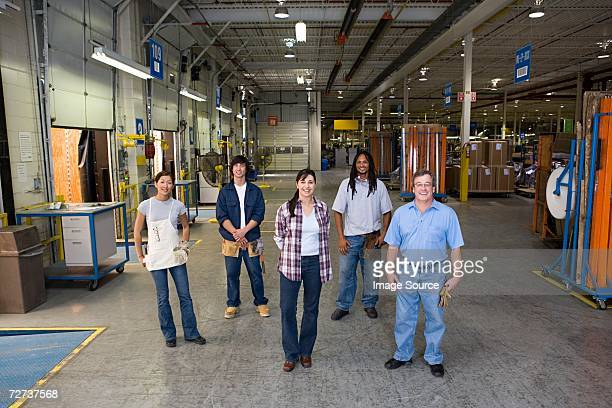 Five workers in a factory