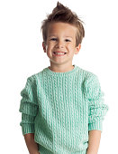Happy five year old European boy posing over white studio background. Child with big smile.