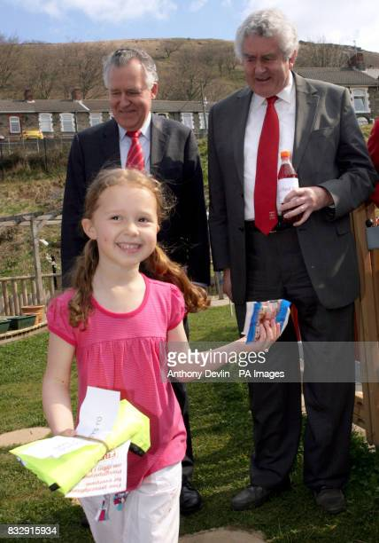 Five year old Georgia Davies has her prize checked by First Minister Rhodri Morgan and Welsh Secretary Peter Hain during an Easter hunt at The...