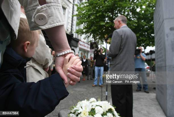 Five year old Shane Byrne whose grandmother Anne Byrne was one of those killed in the 1974 Dublin Monaghan bombings listens to Kevin O'Laughlin of...