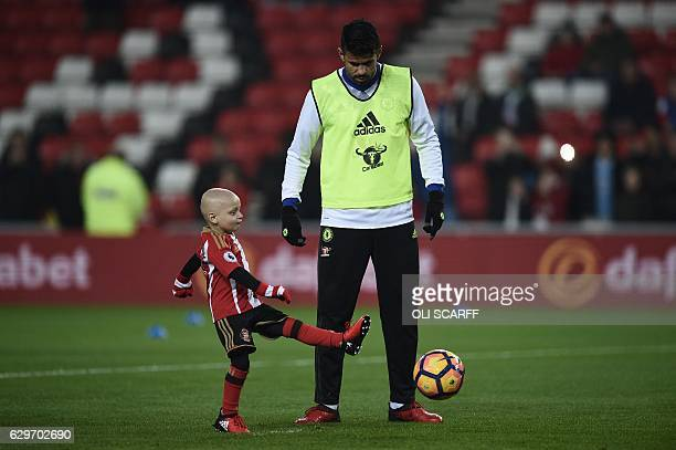 Five year old Sunderland fan and cancer patient Bradley Lowery warms up with Chelsea's Brazilianborn Spanish striker Diego Costa ahead of the English...