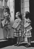 Five year old triplets Julie Judy and Jean Vogt selling a charity newsletter doorto door Ontario Canada circa 1940