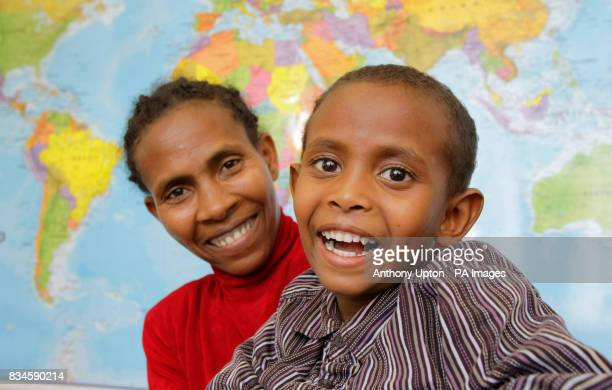 Five year old Zerihun Muche and his mother Turye from Ethiopia at the offices of the charity Facing the World in west London after he came to the UK...