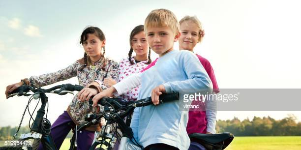 Five young friends with bicycles  outdoors
