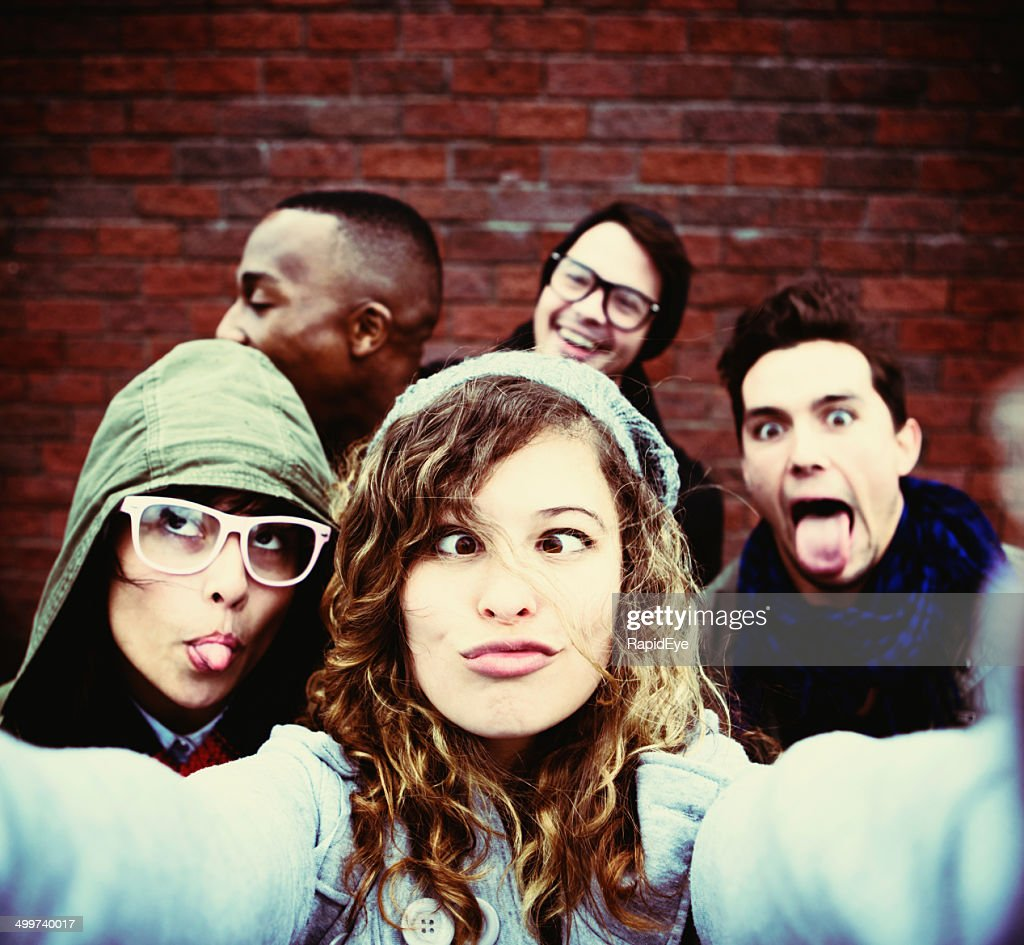 Five youngsters grimace,  taking very silly selfie : Stock Photo