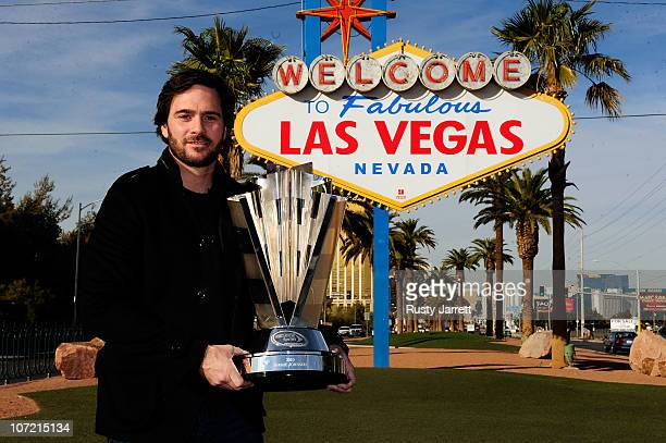 Fivetime NASCAR Sprint Cup Series Champion Jimmie Johnson poses with the 2010 trophy during Day 1 of the NASCAR Sprint Cup Series Champions Week on...