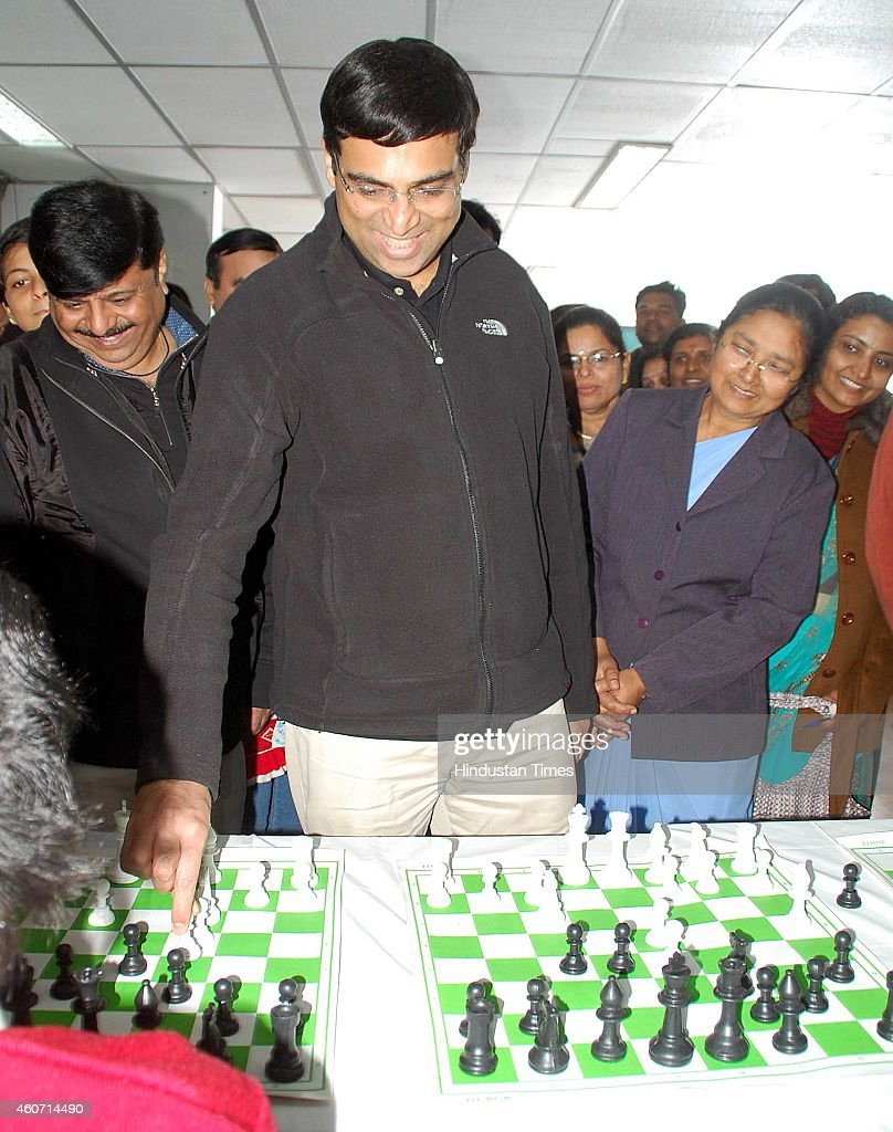 Five-time World Champion and NIIT Mind Champions <a gi-track='captionPersonalityLinkClicked' href=/galleries/search?phrase=Viswanathan+Anand&family=editorial&specificpeople=639502 ng-click='$event.stopPropagation()'>Viswanathan Anand</a> playing chess with school kids during a school funcion at St Rafaels School, on December 20, 2014 in Indore, India.