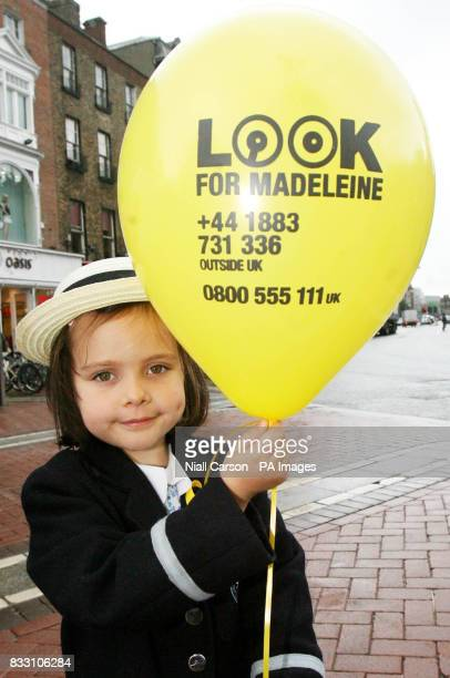 Fiveyearold Amanda Lynch from Hedley Park Montessori school holds one of the 50 balloons released into the sky above Dublin today to mark the 50th...