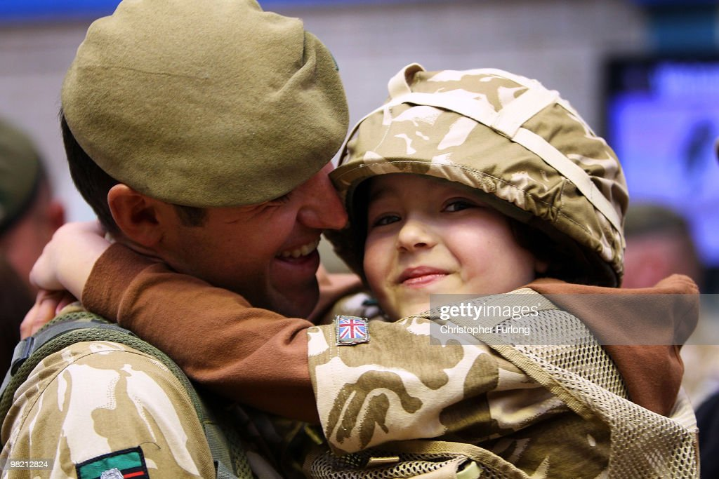 Fiveyearold Ashton Peterson welcomes home his father Sergeant Carl Peterson of 2nd Battalion The Yorkshire Regiment as he returns from Afghanistan at...