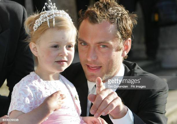 Fiveyearold Ellie Stirling is escorted to the Make a Wish Foundation annual ball at Blenheim Palace Oxfordshire by film star Jude Law