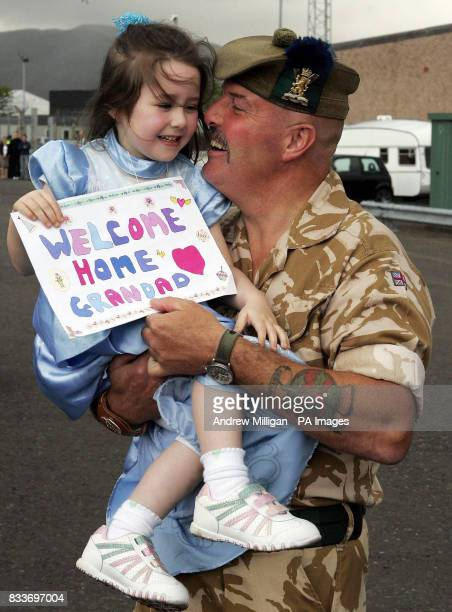 Fiveyearold Erica Ferguson with grandfather 2nd warrant officer Peter McPhee after troops from 51st Highland 7th Battalion Royal Regiment of Scotland...