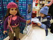 Fiveyearold Jasmine Moawad looks through the book belonging to the American Girl doll Marisol Luna at the American Girl Place store February 3 2005...