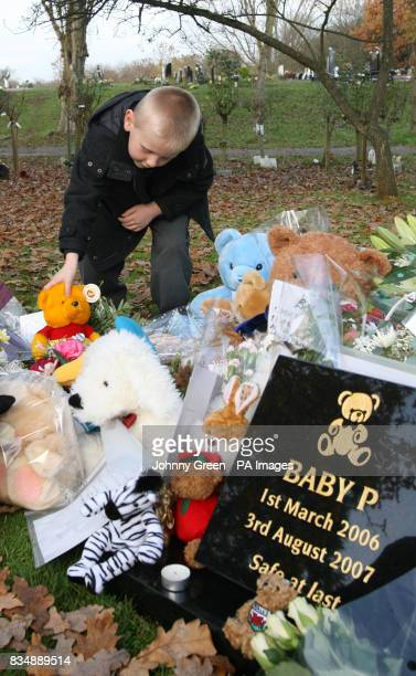 Fiveyearold Nathan Fox from Chingford in Essex sets down a cuddly toy as a tribute to the infant known only as Baby P at the site where his ashes...