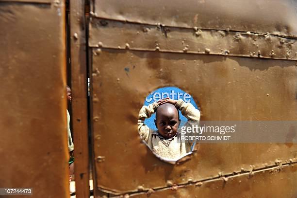 Fiveyearold Peter Otieno stands in the inside courtyard of the preschool he attends in Kibera the largest slum in Kenya on November 29 2010 Peter is...
