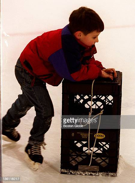 Fiveyearold Scott Casey of Medford uses milk crates for balance as he learns to skate at the MDC's Flynn rink
