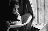 Fiveyearold Seif Salih whose parents were killed in a road side bomb in Diyala province sits at the Safe Iraqi Home orphanage on May 20 2007 in the...