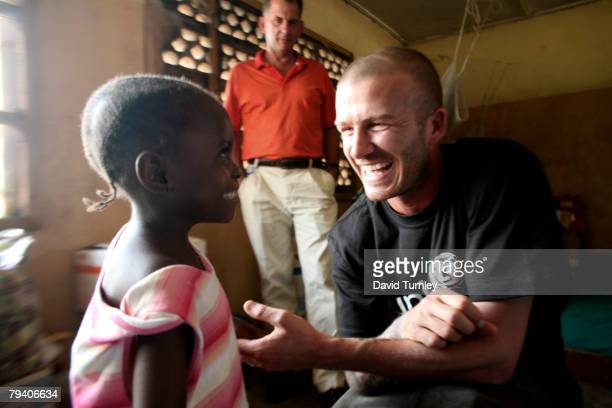 Fiveyearold Senyo tries to walk towards UNICEF Goodwill Ambassador David Beckham during his visit at a therapeutic feeding centre on January 19 2008...