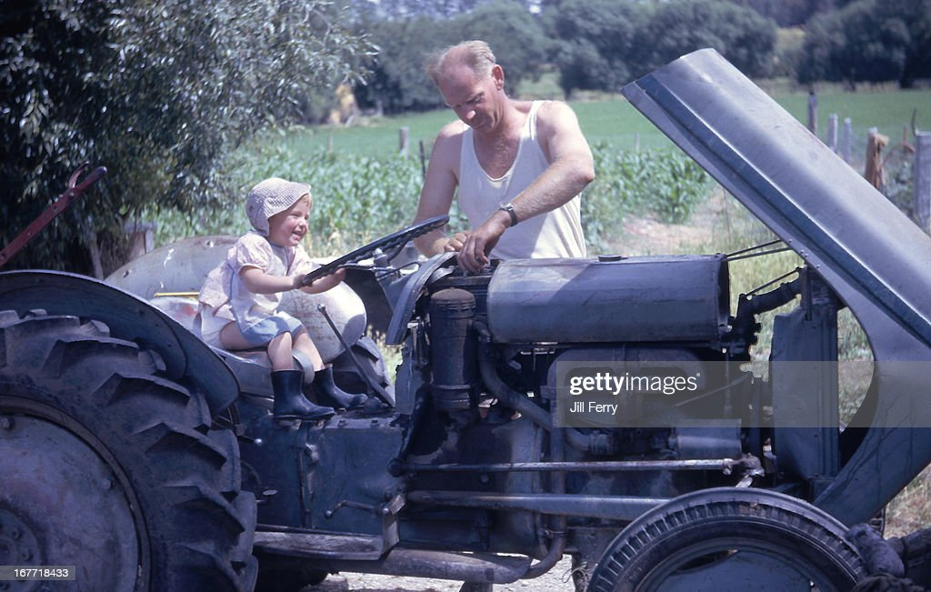 Fixing the tractor : Stock Photo