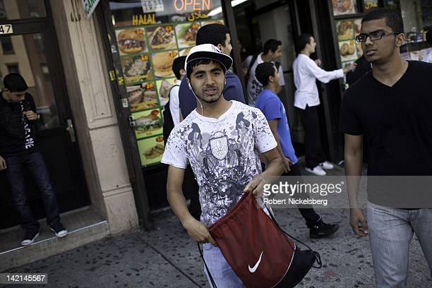 Fizan center and Adnan right leave school after a final exam June 13 2011 at the Al Noor School in the Brooklyn borough of New York Fizan will enter...