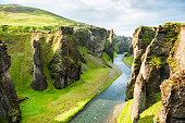 Fjadrargljufur canyon with river and big rocks. South Iceland