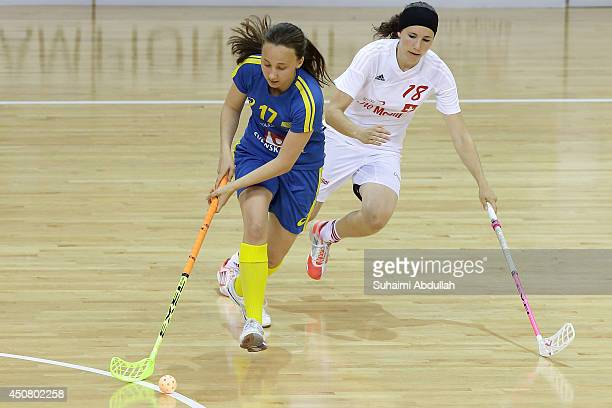 Fjellstedt Cornelia of Sweden and Livia Resegatti of Switzerland challenge for the ball during the World University Championship Floorball match...